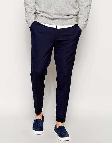 Зауженные брюки с манжетами